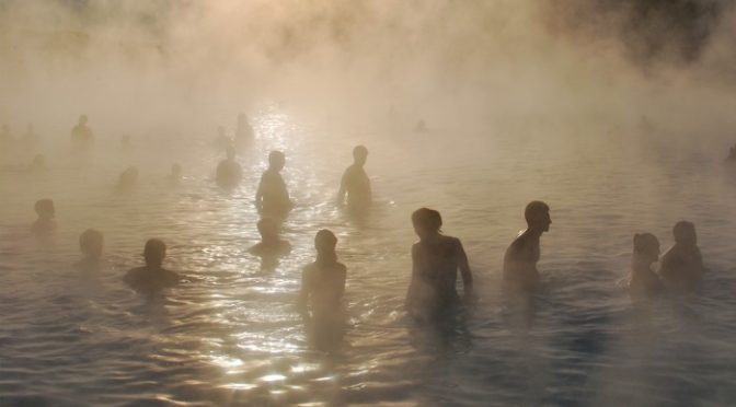 Natural steam blocking with people walking and relaxing at the blue lagoon in Iceland